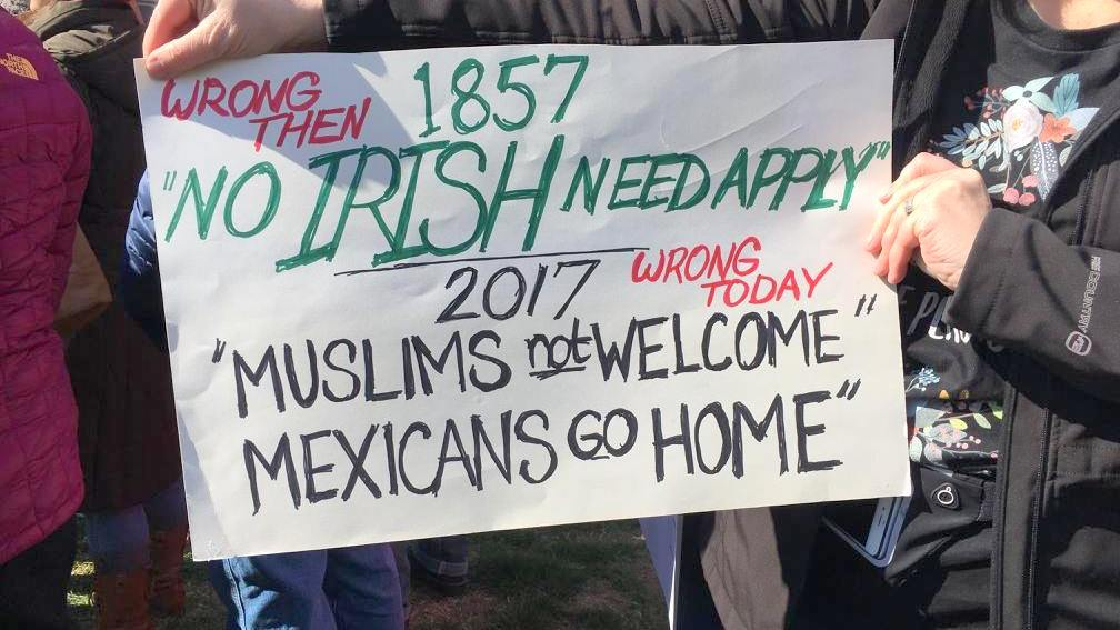 At yesterday's protest against U.S. immigration policy under President Trump, one participant referenced the nearby St. Patrick's Day Parade. (Molly Amster)