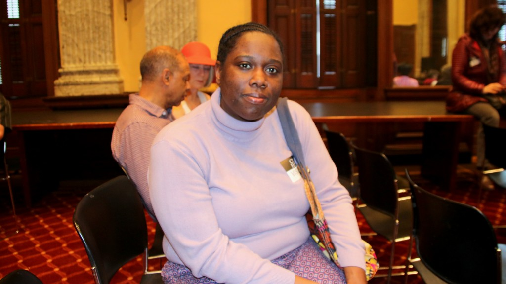 Rojamie Oyennuga, of West Baltimore, awaiting help with a water bill she says is high - and not accurate. (Fern Shen)