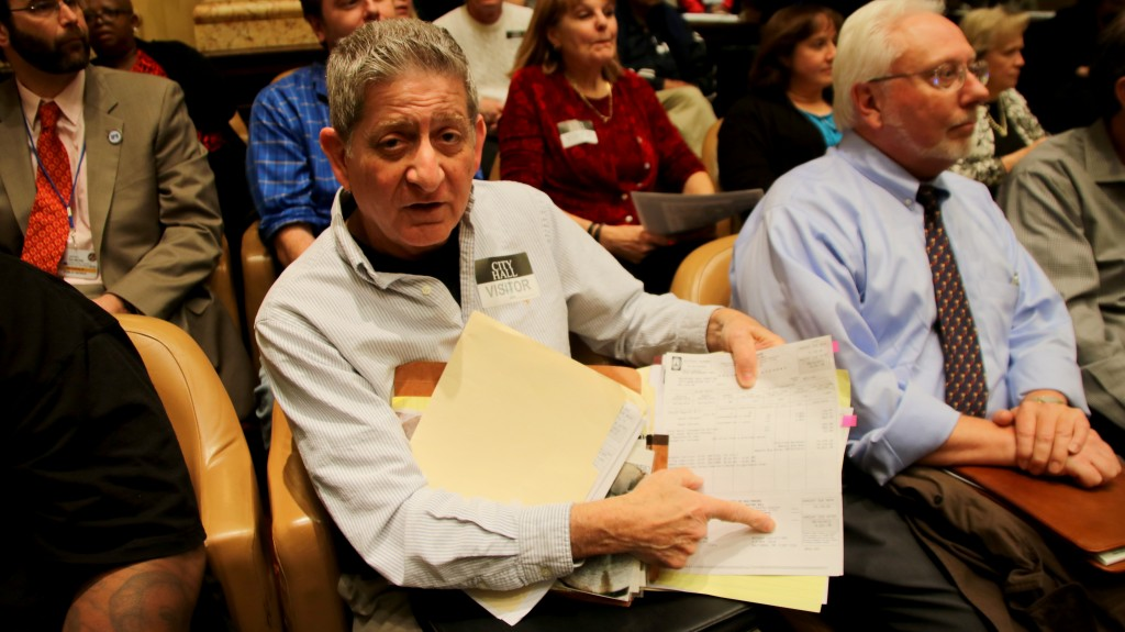 Sal Sabatino came to the hearing with bills going back to 2004. (Fern Shen)