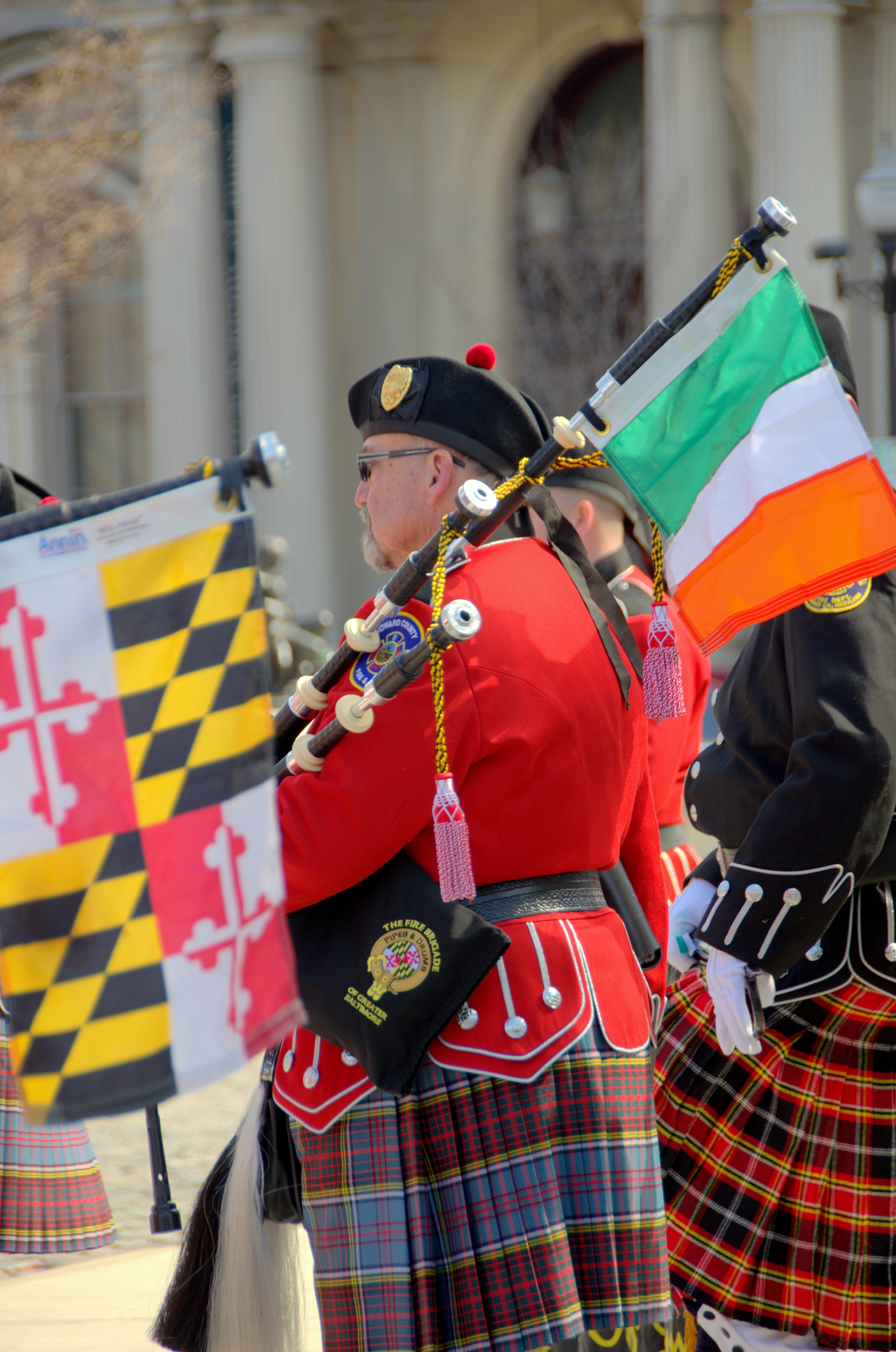 The flags of Ireland and Maryland fly at Baltimore's St. Patrick's Day Parade. (Chris Grant)