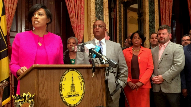 Sagamore Development's Marc Weller stands beside then-Mayor Stephanie Rawlings-Blake, Council President Jack Young and Comptroller Joan Pratt during signing of $660 million TIF financing for Port Coverington last September 28. (Brew file photo)