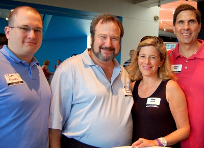 Howard Perlow (second from left) with Josh Perlow and Abby and Rob Hoffman at the 2012 Grand Prix in Baltimore. (bisnow.com)