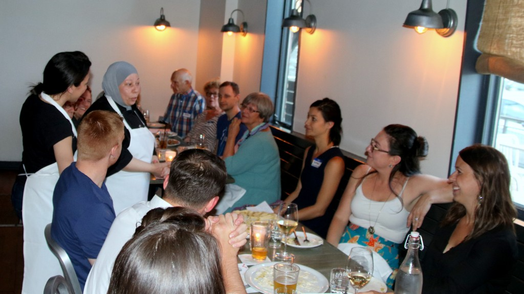 About 60 people gathered to try Iman Ashad's Syrian cooking, as part of a fundraiser for Baltimore area refugees. (Louis Krauss)