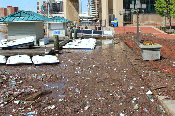 A downpour on April 30, 2014 left this mess at the World Trade Center in the Inner Harbor. Since then, Mr. Trash Wheel and other clean-up efforts have reduced the amount of debris floating in the harbor after storms. (Adam Lindquist, Waterfront Partnership)