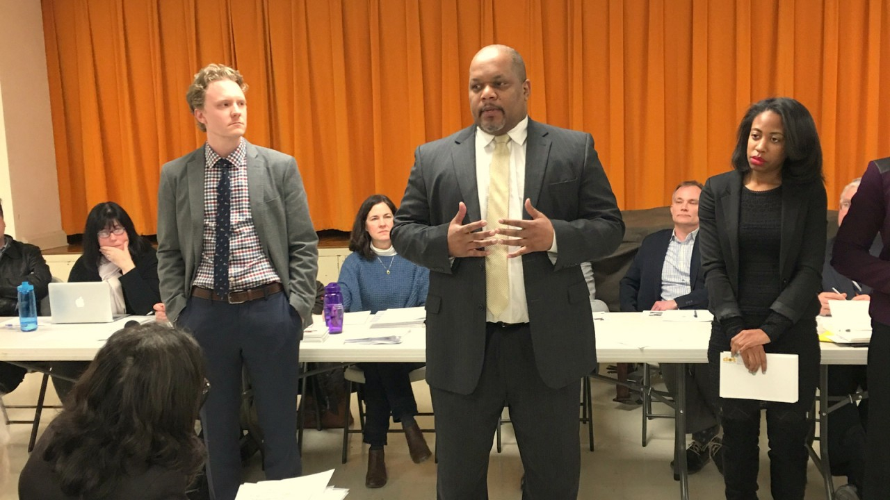 Former DOT director William Johnson addresses the Roland Park Civic League in March 2016 after the controversial launch of the cycle track. To his left is deputy traffic chief Graham Young and at right, northwest liaison Kohl Fallin. (Brew file photo)