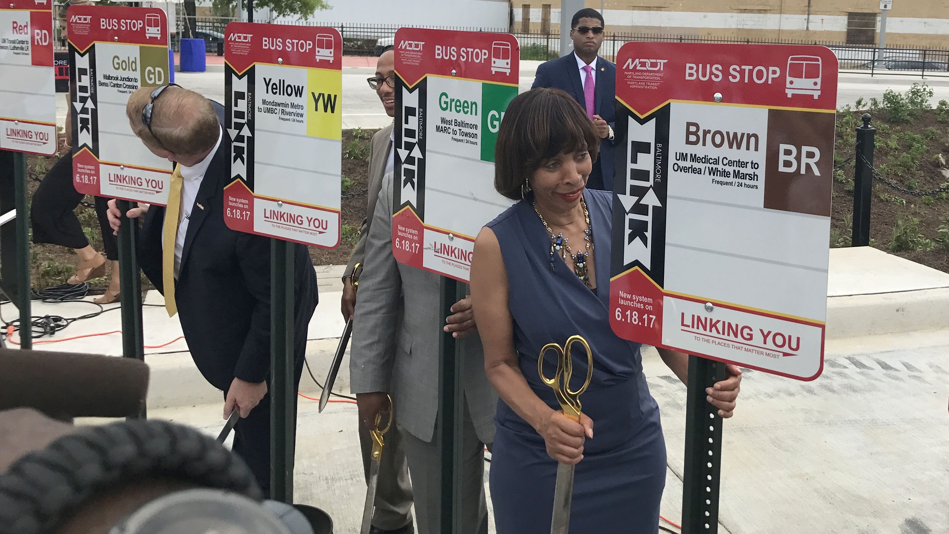 Mayor Catherine Pugh checks out new route signs for the revamped Baltimore region bus system going into effect this weekend. (Louis Krauss)