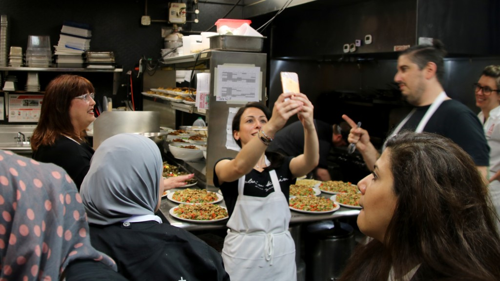The kitchen crew working with Iman Ashab worked hard and had a good time. (Louis Krauss)