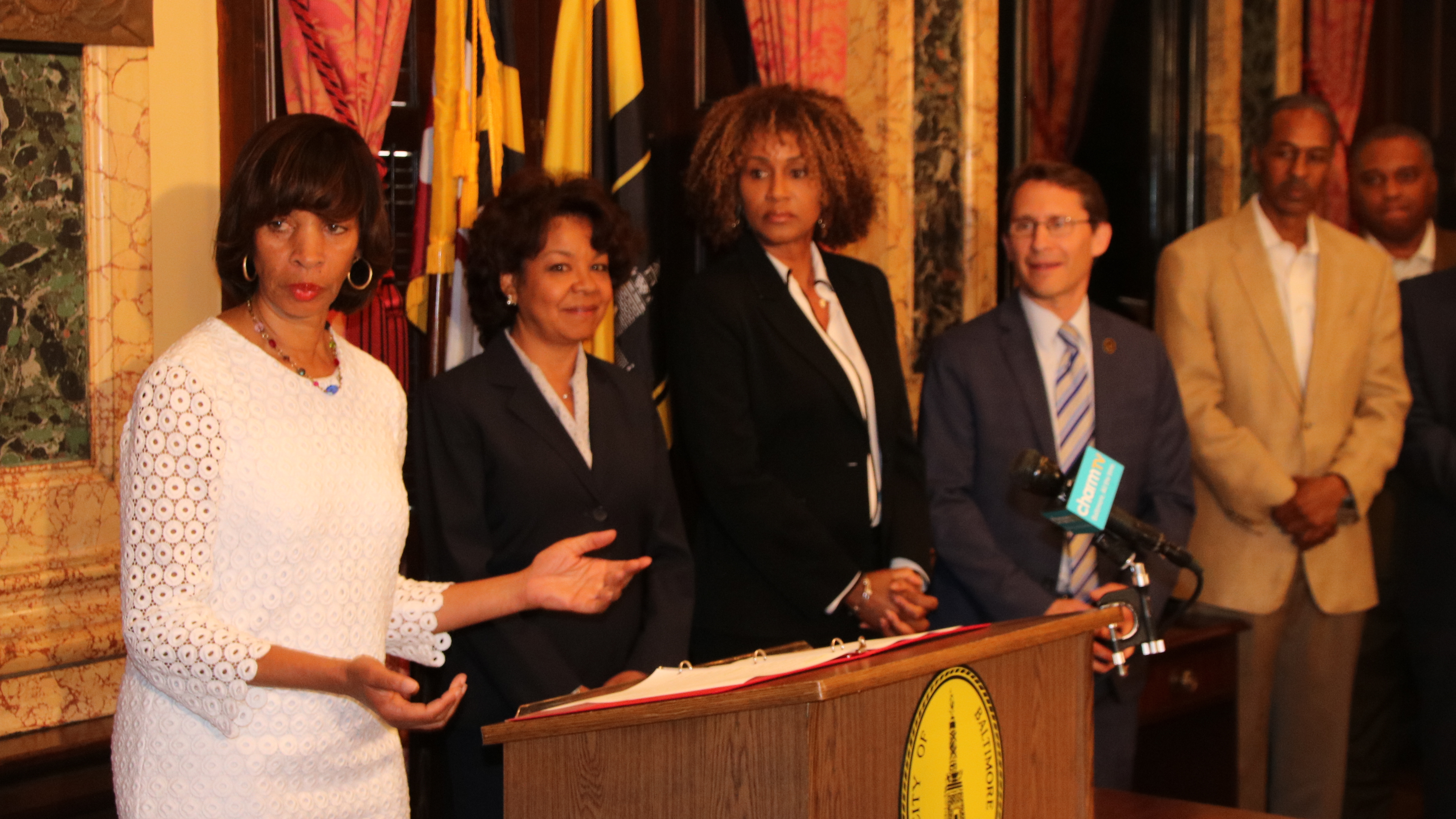 Mayor Catherine Pugh (in white) announces new cabinet picks (l-r) Michelle Pourciau, Janet Abrahams and Michael Braverman. (Louis Krauss)
