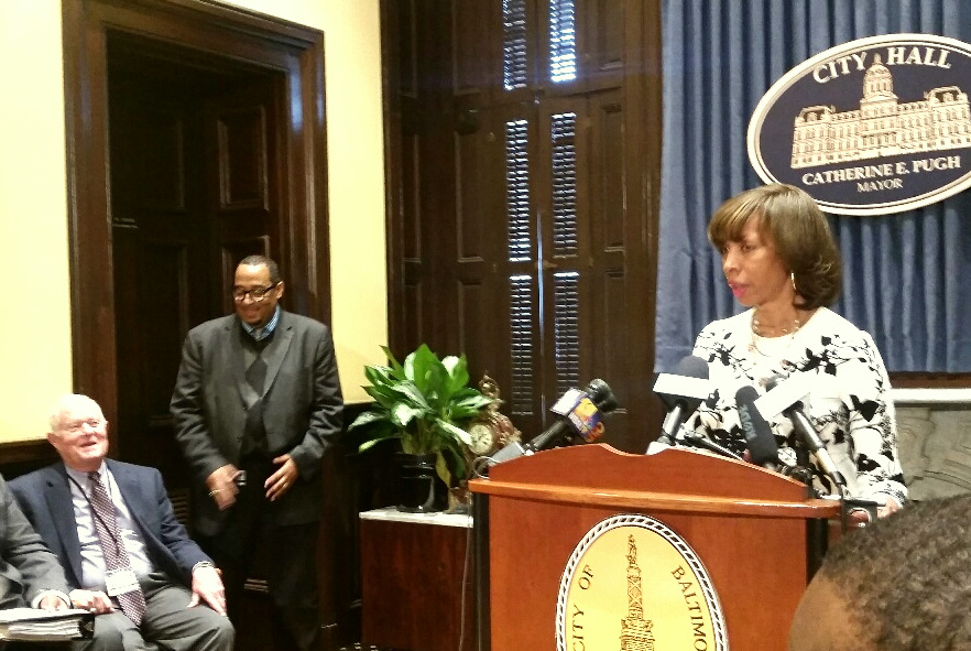 Mayor Catherine Pugh with Jim Smith (seated) at City Hall earlier this year. (Mark Reutter)
