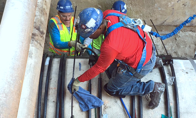Workers install steel reinforcing wires around the concrete pipe segment that showed signs of pending rupture. (Baltimore DPW)