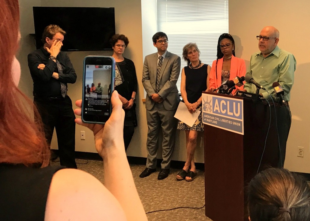 Mark Reutter describes the history of police brutality settlements in Baltimore at the ACLU press conference. (Fox 45 News)