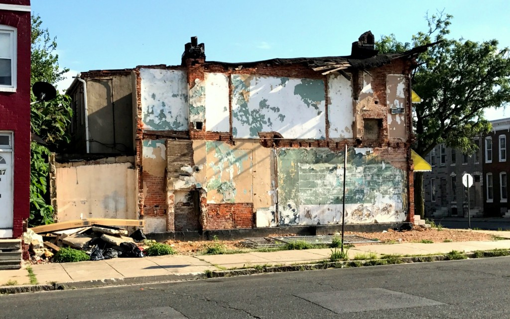 The party wall left exposed by the demolition. The housing code requires a full retaining wall built next to a torn-down rowhouse to insure the integrity of the adjoining building. (Mark Reutter)