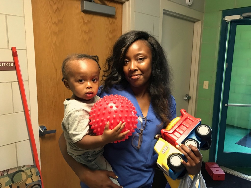 Laquiane Spence, pictured with her son Brandon, grew up in the day care center. (Mark Reutter)