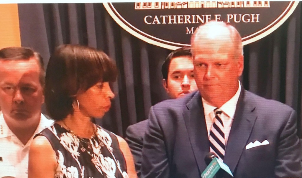 Mayor Catherine Pugh listens as Donald Fry, of the Greater Baltimore Committee, endorses her one-year mandatory sentencing bill. Also shown at the July 14 press conference: Police Commissioner Kevin Davis and (looking over Fry's shoulder) 5th District Councilman Isaac
