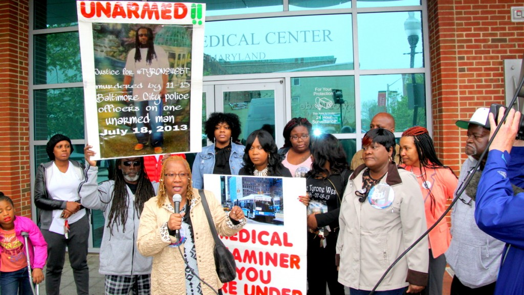 The family of Tyrone West demonstrates in front of the state medical examiner's office in May 2016, calling on State's Attorney Marilyn Mosby to reopen the case. (Louie Krauss)