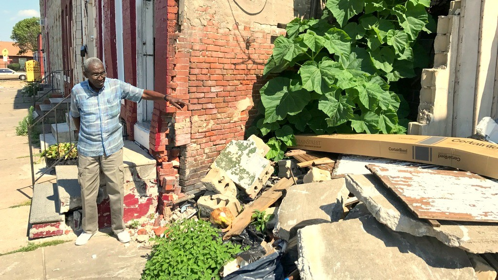 The author points to the rubble and the damage to his property and steps from demolition done by P&J Contracting. (Mark Reutter)