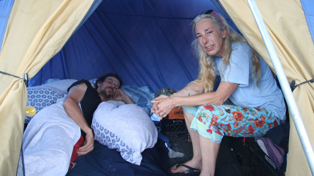 Troy Kolb and Sherry Sellers said they began living in a tent besides the Fallsway in April, after Troy, a carpenter, was laid off. (Fern Shen)