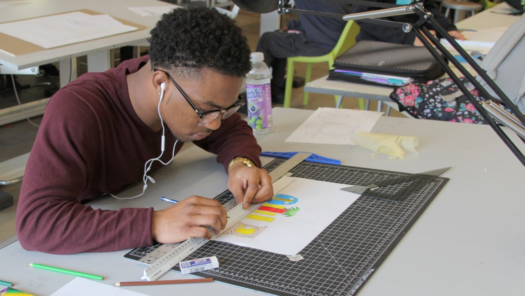 A student from the Baltimore Design School works on drafting a design for the mini-golf project. (Xxxxx)