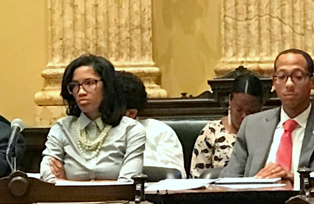 Shannon Sneed, from the Eastside's 13th District, and John Bullock from the Westside's 9th District, listen to testimony. (Mark Reutter)