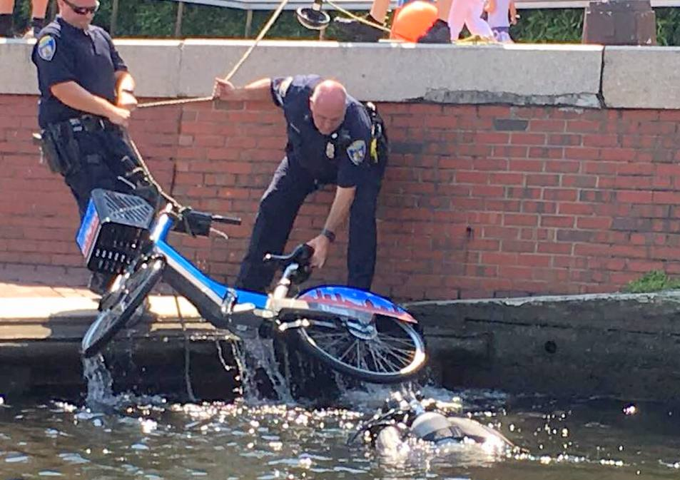 Police pull a Bikeshare bike out of Baltimore's Inner Harbor. (BPD Marine Unit and Underwater Recovery Team)