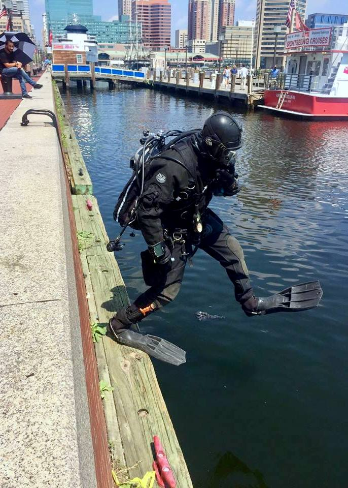 Police diver responding to report of a Bikeshare bike being thrown into the Inner Harbor. (BPD Marine Unit and Underwater Recovery Team)