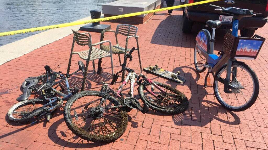 Baltimore police retrieved some bonus items on a recent dive to recover a Bikeshare bike reportedly thrown in the water. (BPD Marine Unit and Underwater Recovery Team)