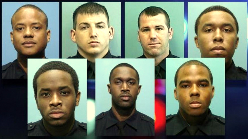 Detective Jemell Rayam, at top left, is shown with the other six members of the Gun Trace Task Force indicted last March. The city tomorrow will pay $70,000 for an erroneous warrant he sworn out in March 2015. (Brew file photo)