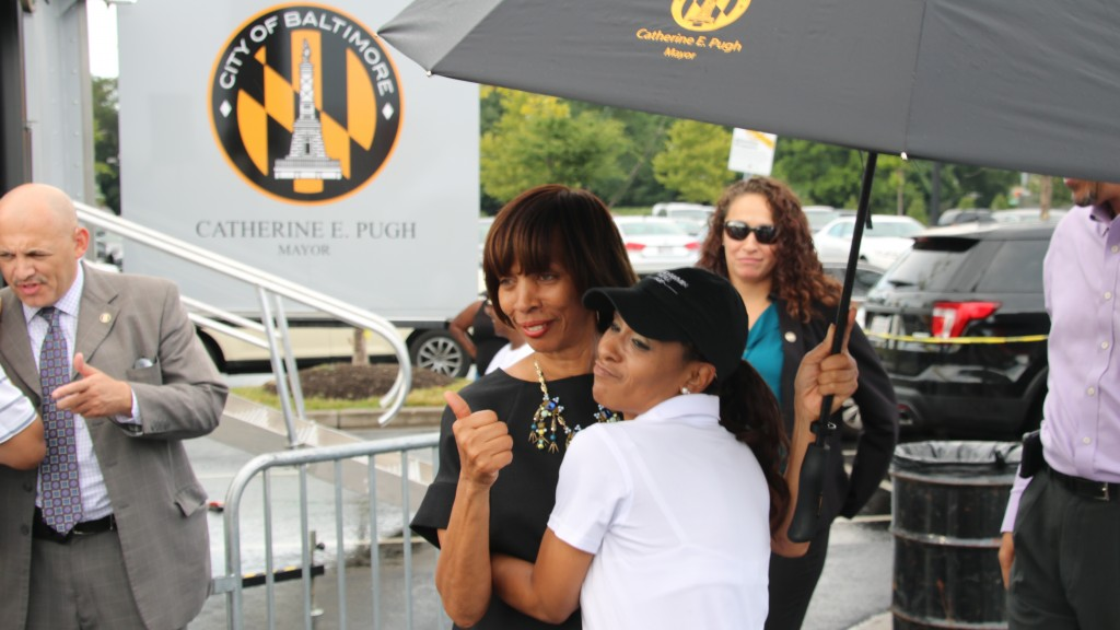 Mayor Catherine Pugh with a participant in National Night Out at Mondawmin Mall. (Louis Krauss)