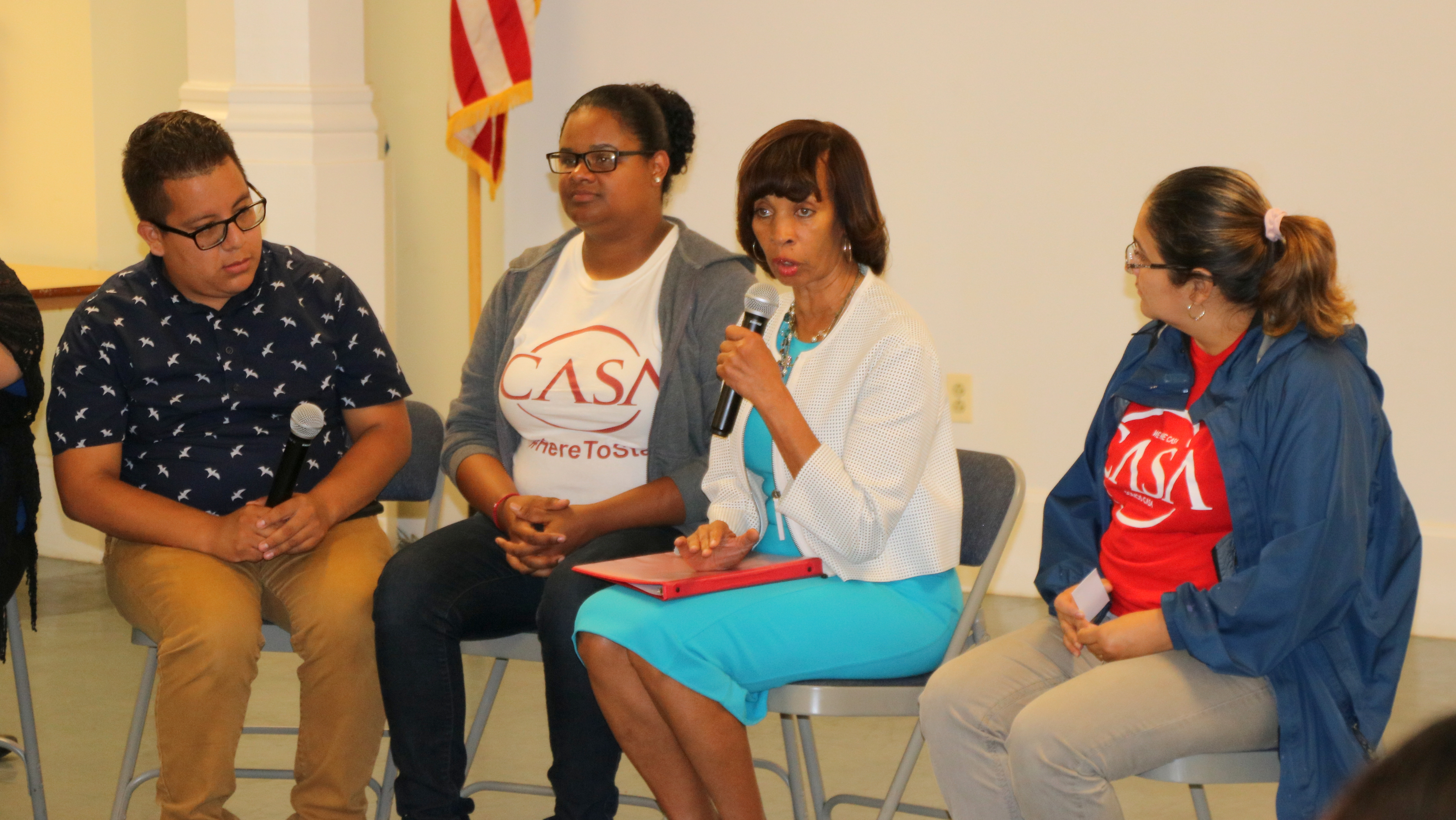 Baltimore Mayor Catherine Pugh says the city supports DACA recipients. At left, Jesus Perez, a CASA member and DACA participant. (Louis Krauss)