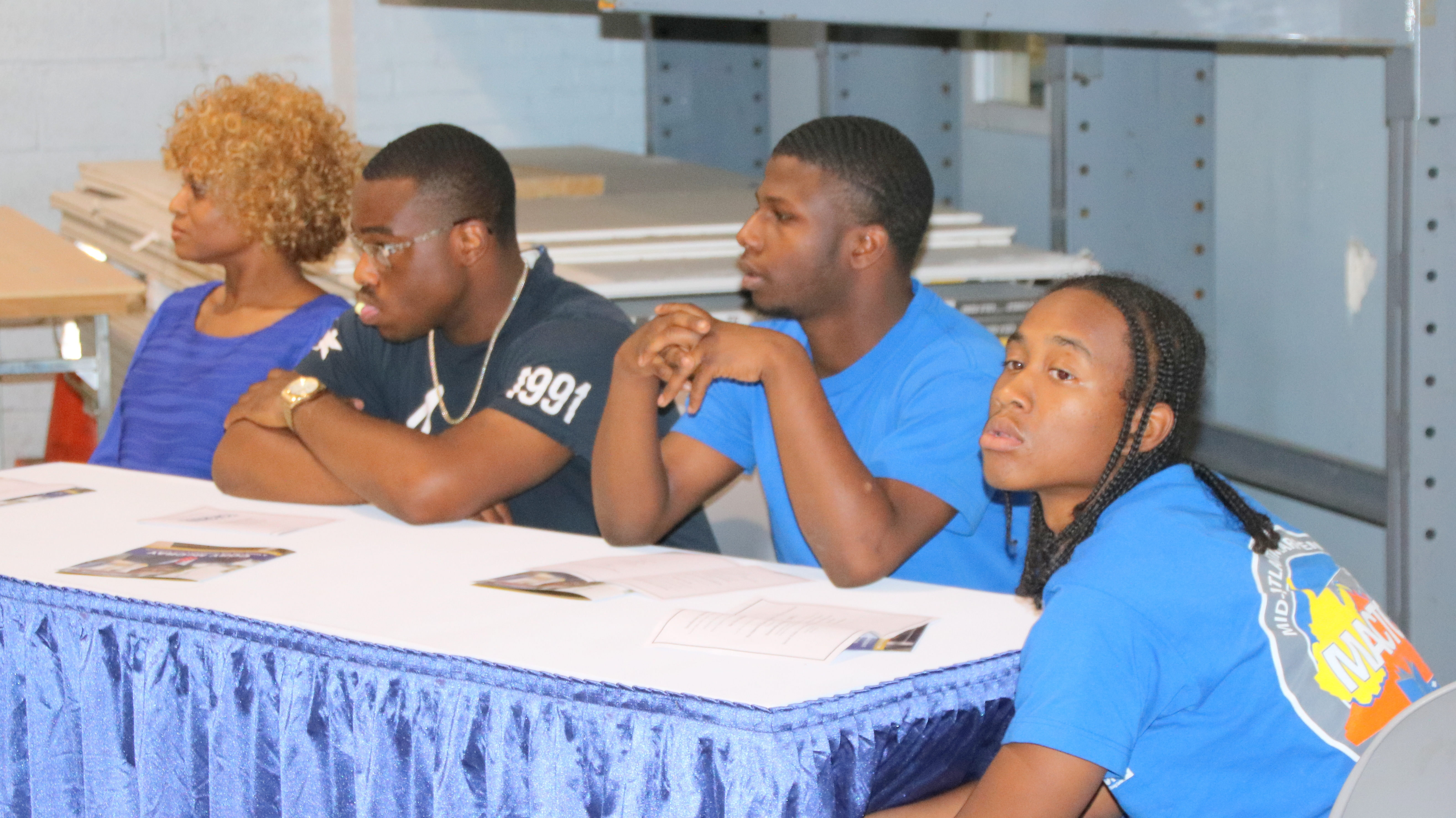 Sha-quita Graham, Neko Whitfield-Smith, Rashard Phillips and Mark Hill at the Carpenters' union pre-apprenticeship graduation luncheon. (Louis Krauss)