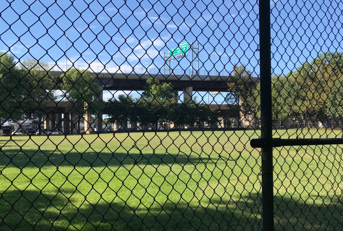 The Solo Gibbs baseball field is often in the shadows of the high elevated ramps of I-395. (Mark Reutter)