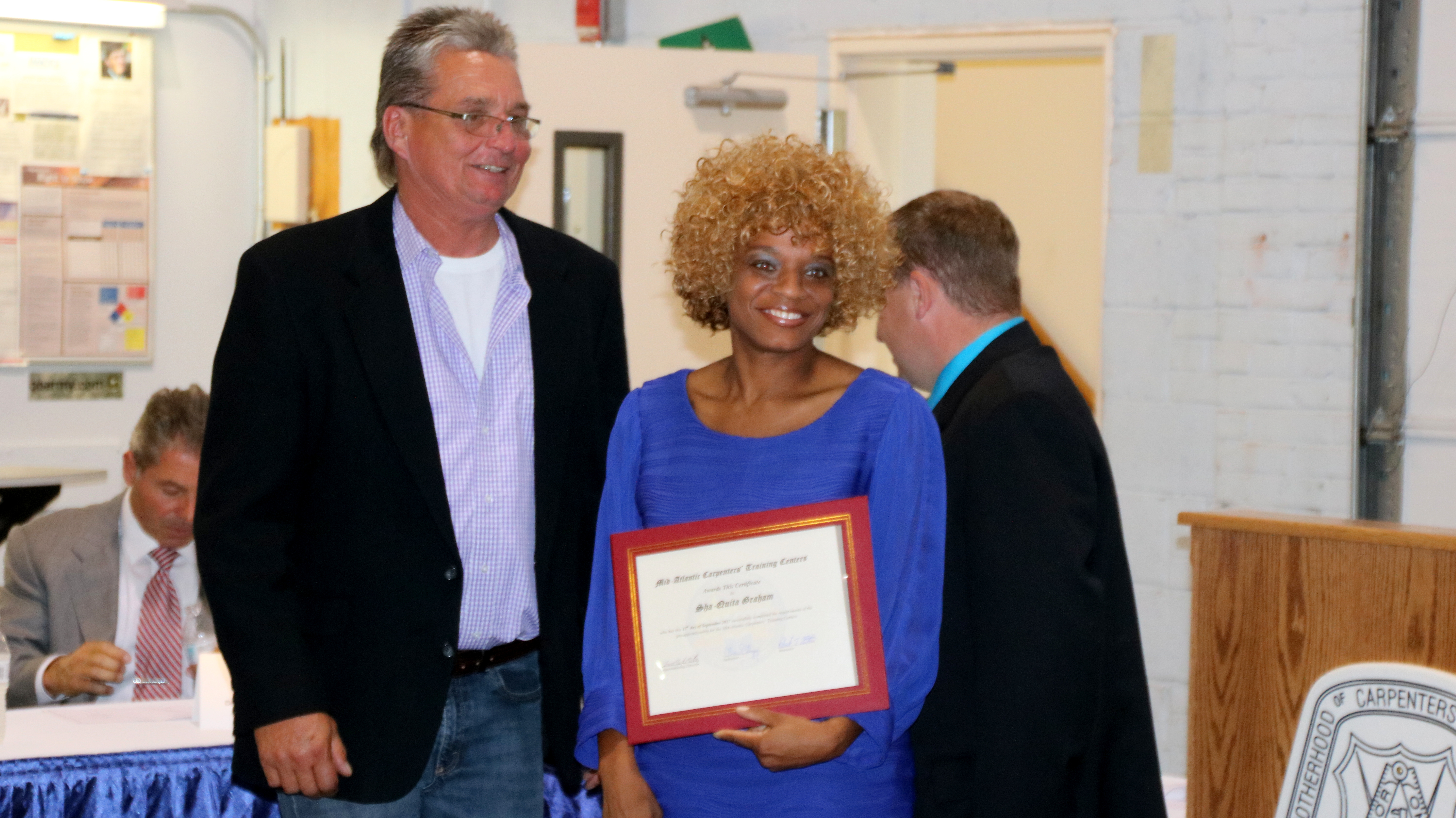 Graduate Sha-quita Graham with instructor Robert Eaton. (Louis Krauss)