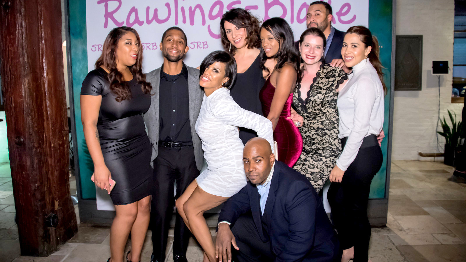 Rawlings-Blake (in white) poses with guests at the Bar Vasquez party, including her chief of staff Kaliope Parthemos (center) and City Councilman Brandon M. Scott (second left). (Glenwood Jackson Studios)