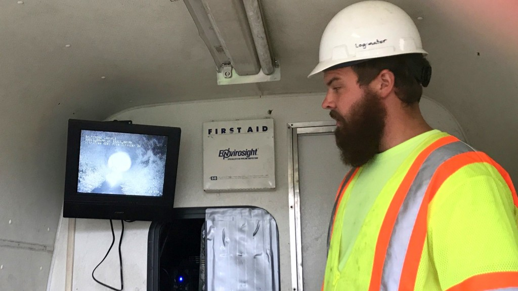 Logan Etzler, of TFE Resources, monitors the progress of the fatburger breakup. An estimated that 85% of the 24-inch pipe was blocked. (Mark Reutter)