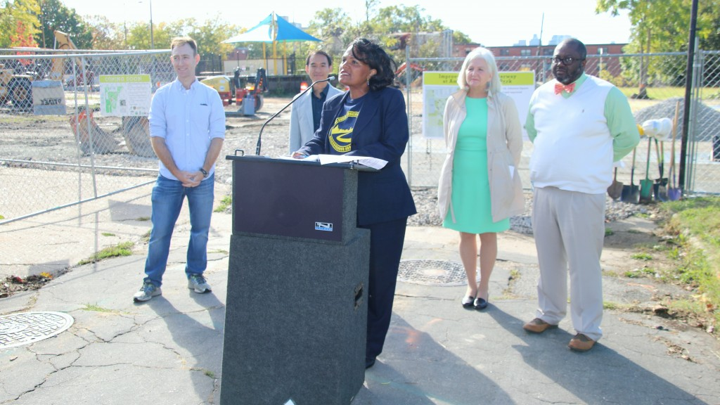 From left, Scott Goldman, of The Sixth Branch, XX, of TRF, Regina Hammond, of Rebuild Johnston Square, Lisa Schroeder of Parks & People Foundation. (Fern Shen)