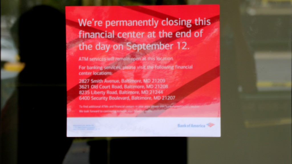 At now-shuttered 6538 Reisterstown Road branch, a sign directs customers to other Bank of America locations. (Fern Shen)