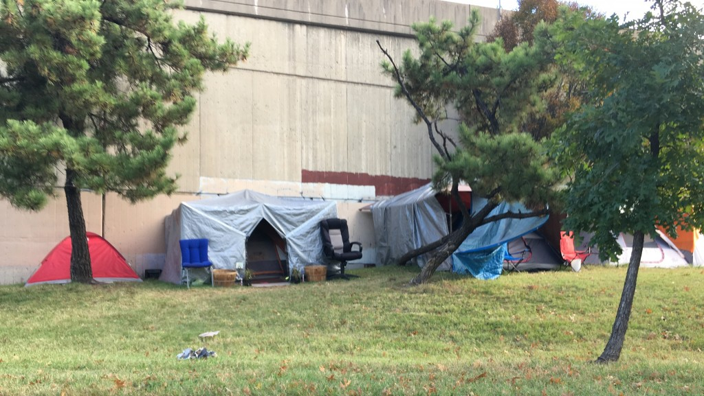 People living in tents along an on-ramp to Russell Street, near Ravens stadium. (Fern Shen)