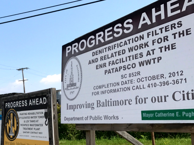 PROGRESS AHEAD? City signage touts all of the costly contracts that have been awarded to fix the Patapsco plant's longstanding deficiencies. (Mark Reutter)