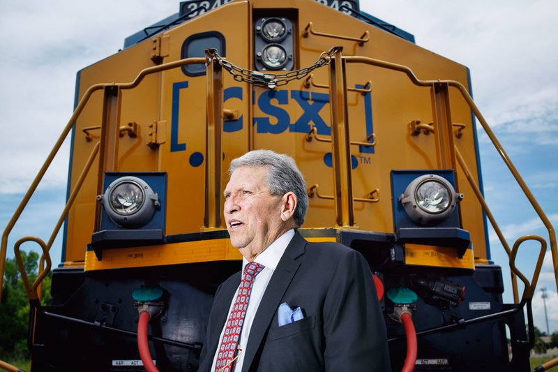 Hunter Harrison poses in front of a CSX locomotive at a recent Fortune Magazine photo shoot. (Melissa Golden for Fortune)
