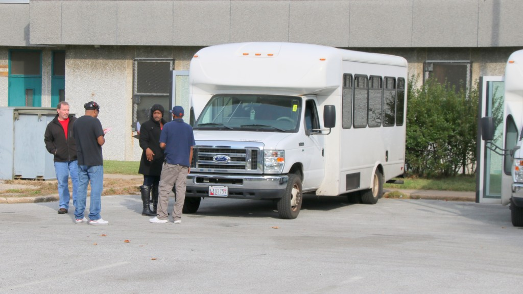 A van is readied to carry Pinderhughes inhabitants to their new quarters at East Baltimore's Helping Up Mission. Pinderhughes has been designated as a