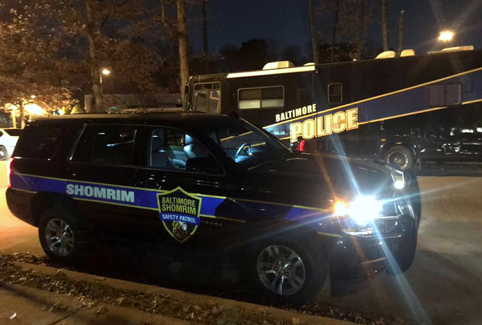 The Chevy Tahoe command vehicle for Shomin mimics the color and styling of Baltimore Police, as seen by the BPD van parked behind it. (Baltimore Jewish Life)