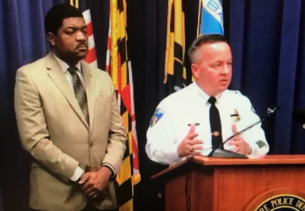 Police Department spokesman T.J. Smith listens as Police Commissioner Kevin Davis addresses the media late this afternoon. (BPD)