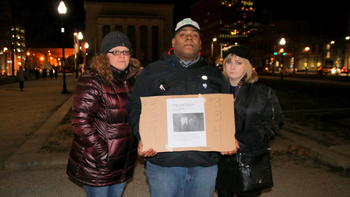 Jen Ayers, Jerrod Sydnor and Kelly Langley came to the vigil to remember Jim Forrester. (Fern Shen)