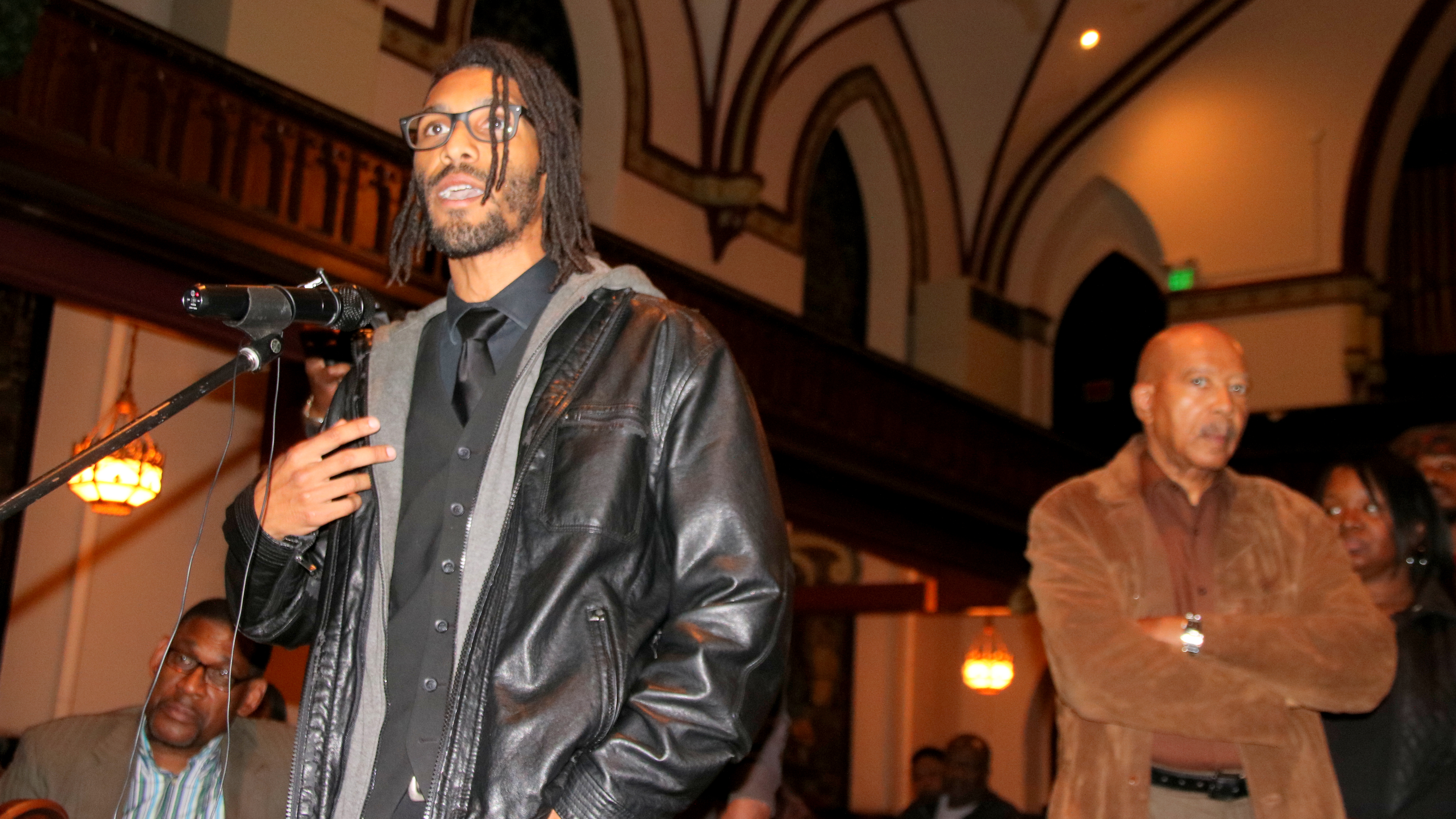 Justin Sanders addresses Baltimore's Civilian Review Board at the Metropolitan United Methodist Church. (Fern Shen)