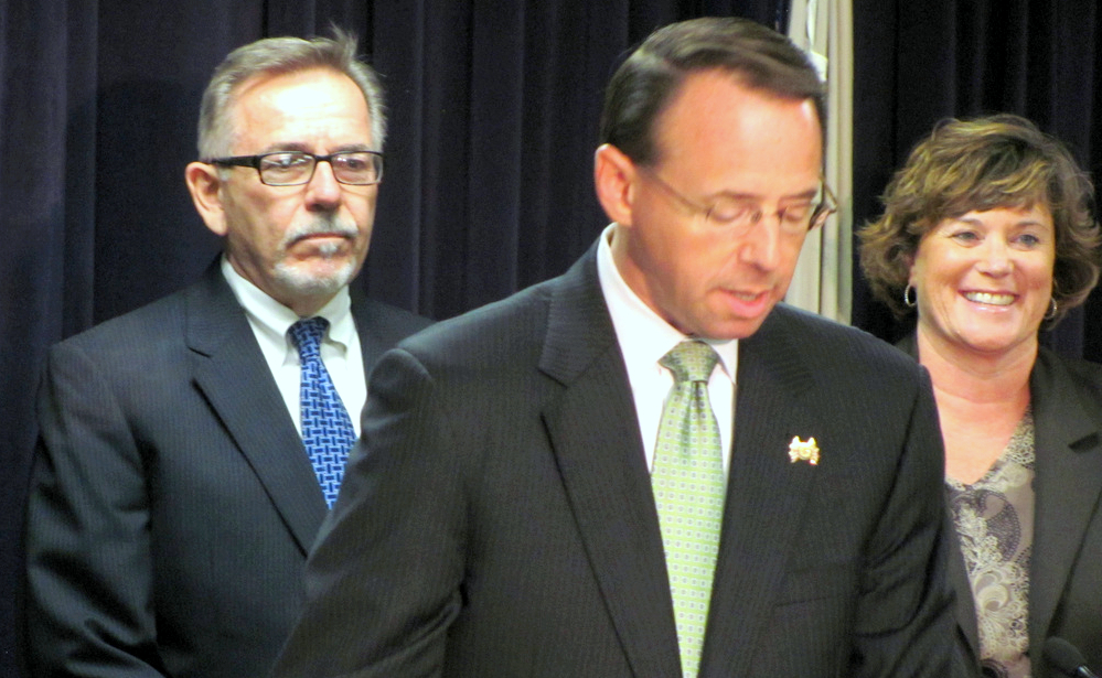 Robert Pearre stands beside U.S. Attorney Rod Rosenstein and IRS agent Kathy Montemorra during the June 2015 announcement of federal bribery, thief and extortion charges against five city landfill employees. All later pleaded guilty. (Mark Reutter)