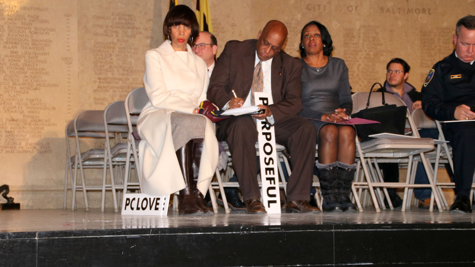 Mayor Pugh, Council President Jack Young, Comptroller Joan Pratt and Police Commissioner Kevin Davis onstage in the War Memorial Building. (Fern Shen)