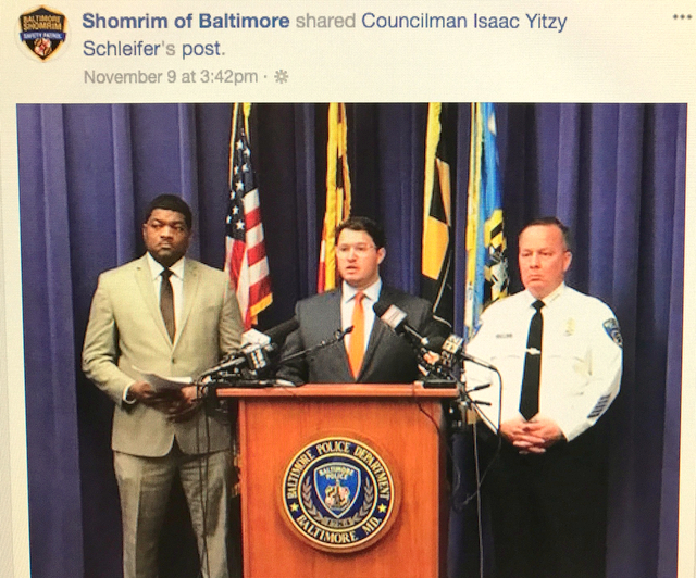 Shomrim shared on its Facebook book this photo of Councilman Schleifer speaking at a press conference last month, flanked by Police Spokesman T.J. Smith and Commissioner Kevin Davis.
