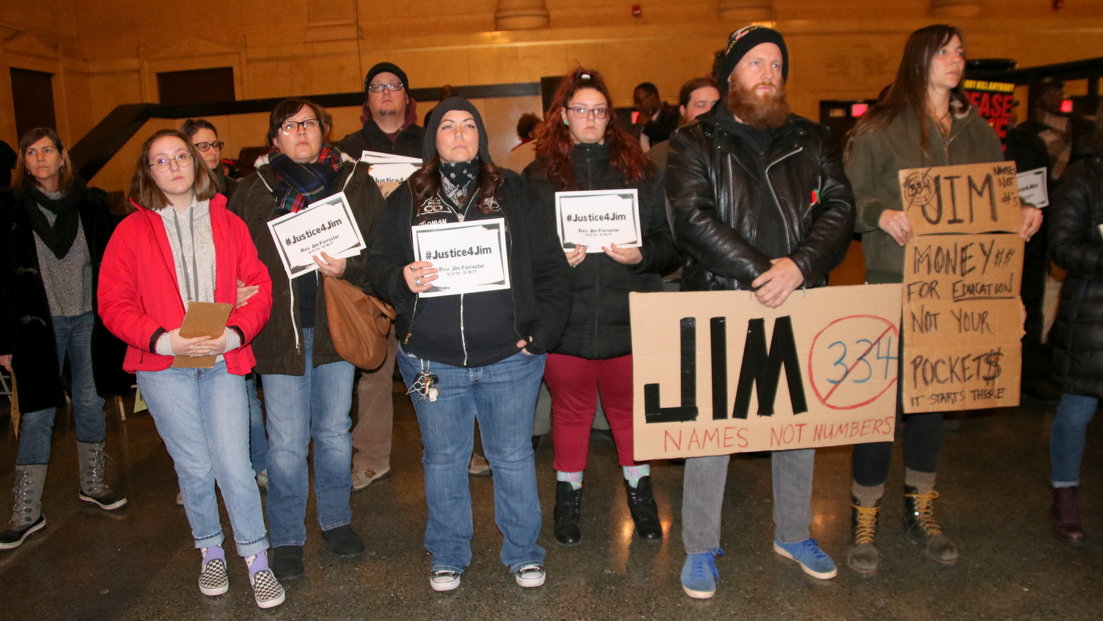 Several participants in Mayor Pugh's candlelight vigil came to remember slain musician Jim Forrester. (Fern Shen)