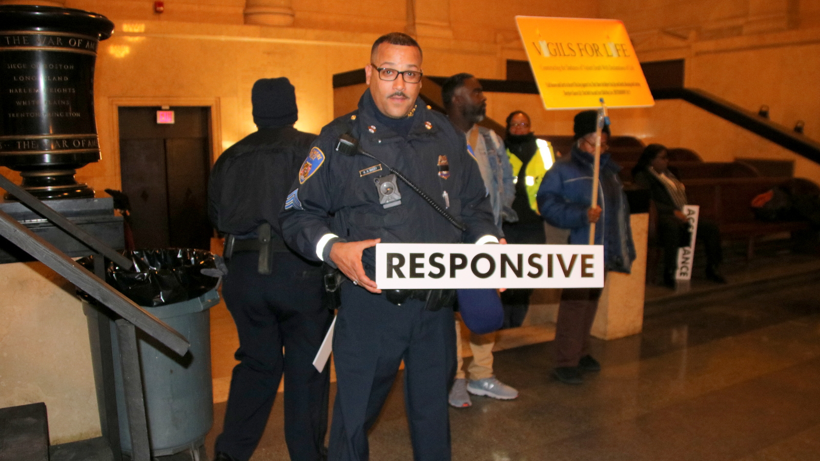Police officers were among the many city employees who held the official signs. (Fern Shen)
