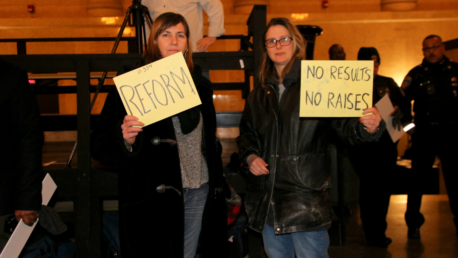 These participants brought their own signs, one of which referred to the raises the mayor and city council members will be receiving come January 1. (Fern Shen)